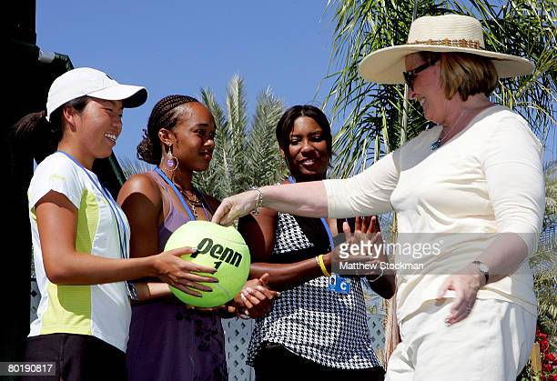 Players Vania King, Angela Haynes and Asha Rolle, with the help of spectator Leslie Polsinello, participate in the main draw ceremony for the Pacific...