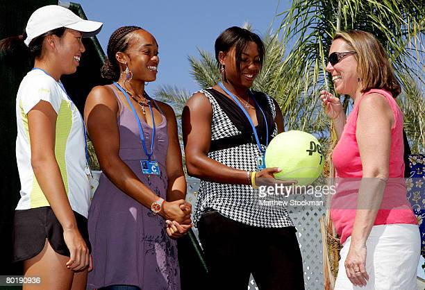 Players Vania King, Angela Haynes and Asha Rolle, with the help of spectator Mary Ellen Cole, participate in the main draw ceremony for the Pacific...