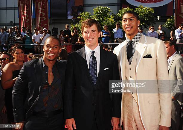 NFL players Victor Cruz and Eli Manning of the New York Giants and NBA player Anthony Davis of the New Orleans Hornets arrive at the 2012 ESPY Awards...