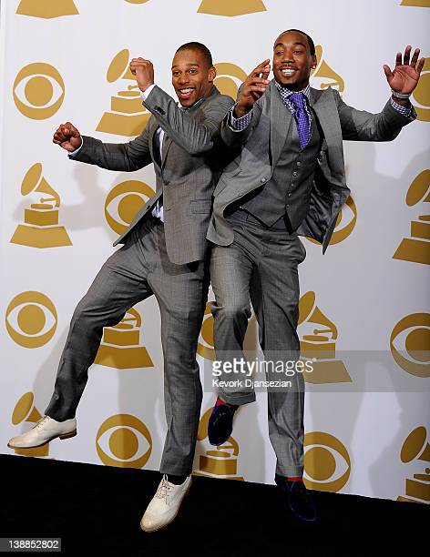 NFL players Victor Cruz and Mario Manningham of the New York Giants pose in the press room at the 54th Annual GRAMMY Awards at Staples Center on...
