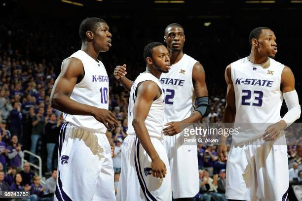 Players Victor Ojeleye, Jacob Pullen, Jamar Samuels and Dominique Sutton of the Kansas State Wildcats look to the bench during a game against the...