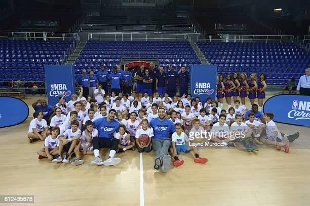 Players Victor Oladipo Mitch McGary Josh Huestle Chris Wright Semaj Christon Kaleb Tarczweski pose with participates during the NBA Cares Clinic as...