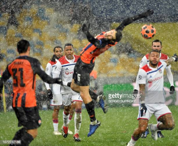 Players vie for the ball during the UEFA Champions League Groupe F football match FC Shakhtar Donetsk and Olympique Lyonnais on NSK Olimpiyskyi...