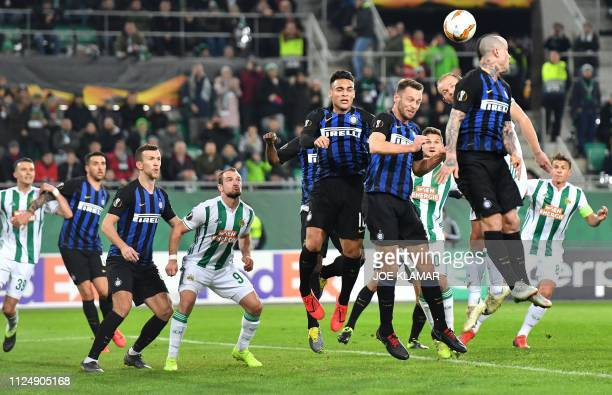 Players vie for the ball during the UEFA Europa League round of 32 firstleg football match between Rapid Wien and Inter Milan in Vienna on February...
