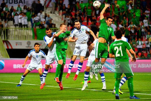 Players vie for the header during the 2019 AFC Asian Cup group F football match between Turkmenistan and Uzbekistan at the Maktoum Bin Rashid...