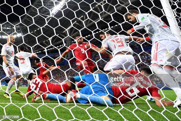 TOPSHOT Players vie for the loose ball during the Russia 2018 World Cup Group B football match between Iran and Spain at the Kazan Arena in Kazan on...