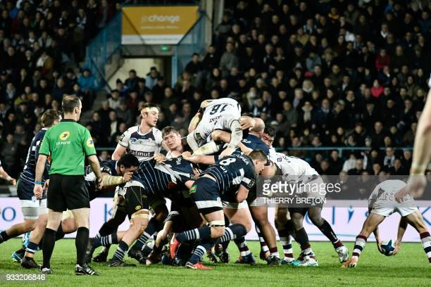 Players vie in a scrum during the French Top 14 rugby union match between Agen and Bordeaux Begles on March 17 2018 at the Armandie Stadium in Agen...