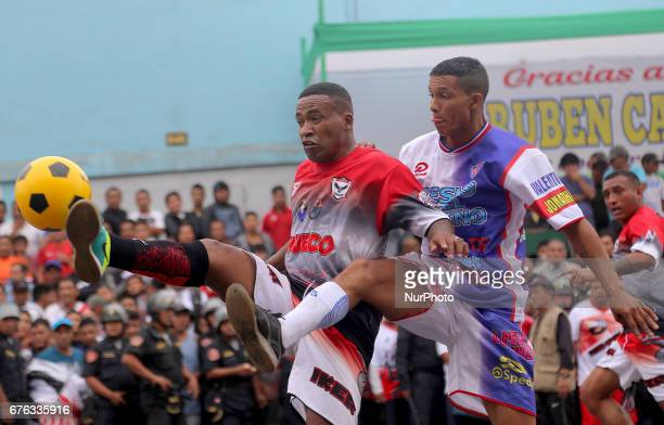 Players vies the ball during a soccer street game in Lima Peru May 1 2017 For 64 years every May 1st is celebration the Mundialito de El Porvenir in...