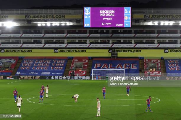 Players wait around as the goal from Jordan Ayew of Palace is disallowed by the Video Assistant Referee for offside during the Premier League match...
