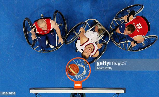 Players wait for a rebound during the Bronze Medal Wheelchair Basketball match between the United States and Great Britain at the National Indoor...