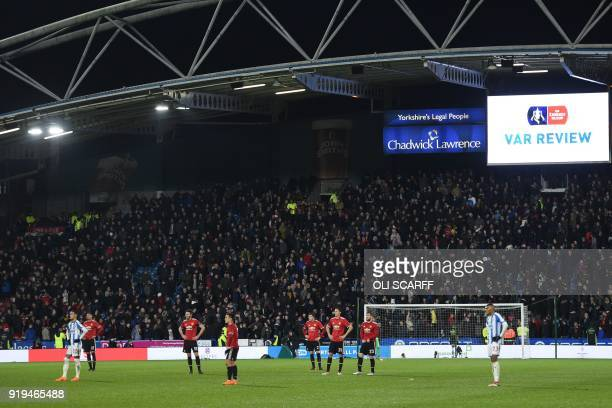 Players wait for a VAR decision to check on an offside decision for a Juan Mata goal during the English FA Cup fifth round football match between...