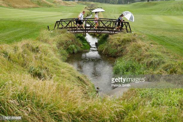 Players walk across the bridge on the on the sixth hole during the second round of the LPGA Drive On Championship at Inverness Club on August 1, 2020...