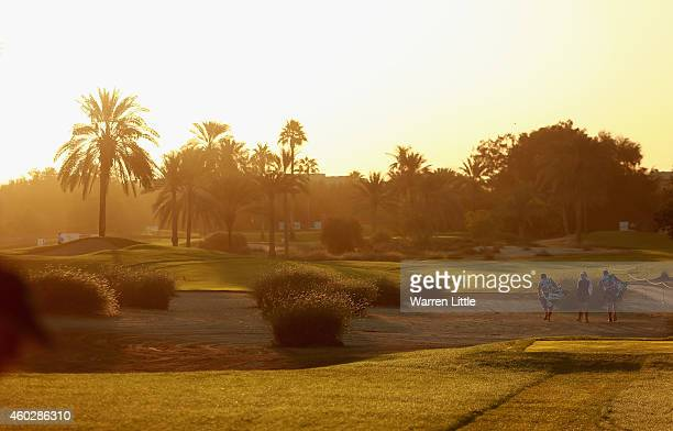 Players walk down the 10th fairway as they start the second round of the Omega Dubai Ladies Masters on the Majlis Course at the Emirates Golf Club on...