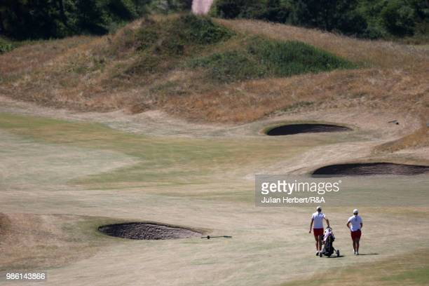 Players walk down the 11th fairway during day three of The Ladies' British Open Amateur Championship at Hillside Golf Club on June 28 2018 in...
