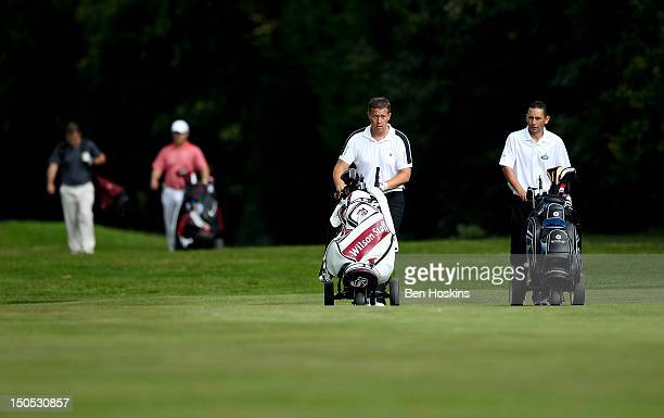 Players walk down the 16th hole during the Regional Final of the Virgin Atlantic PGA National ProAm Championship at Camberley Heath Golf Club on...