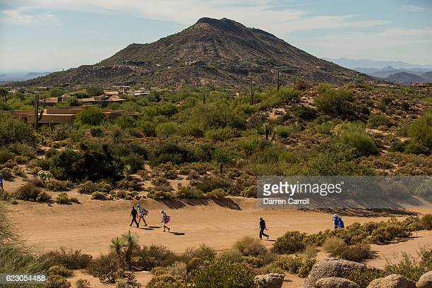 Players walk from the first tee during the final round of the Charles Schwab Cup Championship on the Cochise Course at Desert Mountain on November 13...