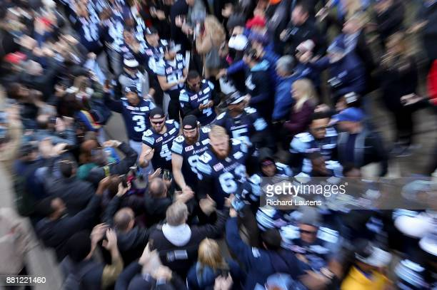 TORONTO ON NOVEMBER 28 Players walk in from the busses towards the celebration The Toronto Argonauts football club celebrated their Grey Cup victory...