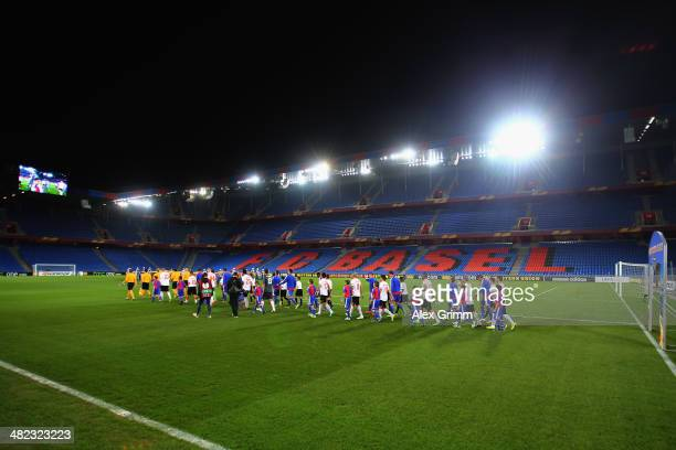 Players walk into the empty stadium for the UEFA Europa League Quarter Final first leg match between FC Basel 1893 and FC Valencia at St JakobPark on...