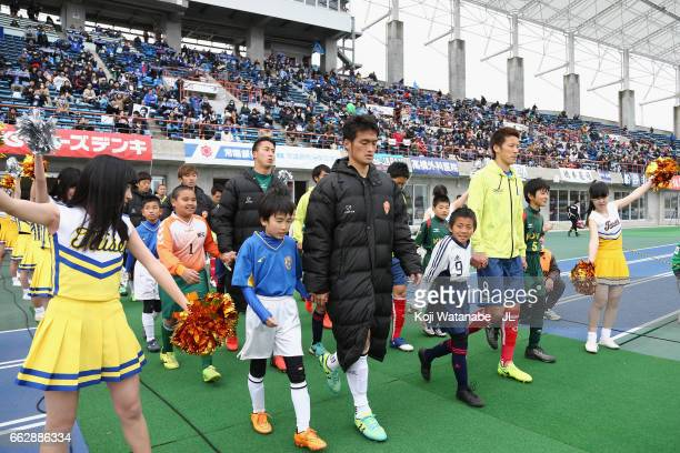 Players walk into the pitch prior to the JLeague J2 match between Mito Hollyhock and Renofa Yamaguchi at K's Denki Stadium on April 1 2017 in Mito...
