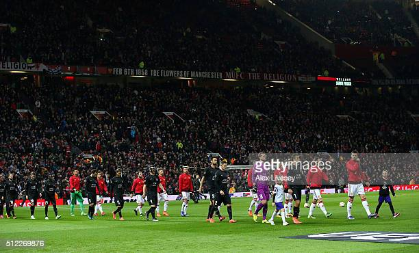 Players walk into the pitch prior to the UEFA Europa League Round of 32 second leg match between Manchester United and FC Midtjylland at Old Trafford...