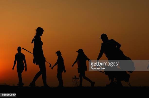 Players walk off the 17th tee during Day One of the Fatima Bint Mubarak Ladies Open at Saadiyat Beach Golf Club on November 1 2017 in Abu Dhabi...