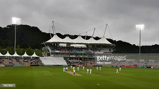 Players walk off under the glare of the floodlights as the rain starts during the Hampshire v Sussex LV County Championship match at the Roswbowl on...