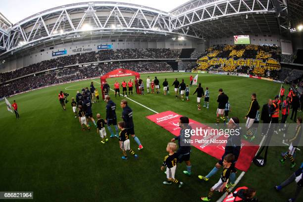 Players walk on the pitch ahead of the Allsvenskan match between Djurgardens IF and AIK at Tele2 Arena on May 22 2017 in Stockholm Sweden