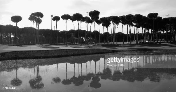 Players walk onto the 11th green during the third round of the Turkish Airlines Open at the Regnum Carya Golf Spa Resort on November 4 2017 in...