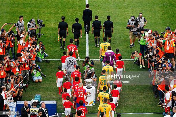 Players walk onto the field during the 2015 Asian Cup final match between Korea Republic and the Australian Socceroos at ANZ Stadium on January 31...