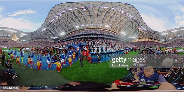Players walk onto the pitch before the UEFA EURO 2016 Group B match between England and Russia at Stade Velodrome on June 11 2016 in Marseille France