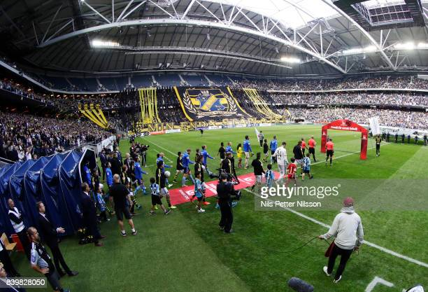 Players walk onto the pitch prior to the Allsvenskan match between AIK and Djurgardens IF at Friends arena on August 27 2017 in Solna Sweden
