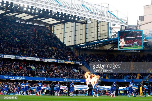 Players walk out ahead of the English Premier League football match between Chelsea and Everton at Stamford Bridge in London on March 8, 2020. /...