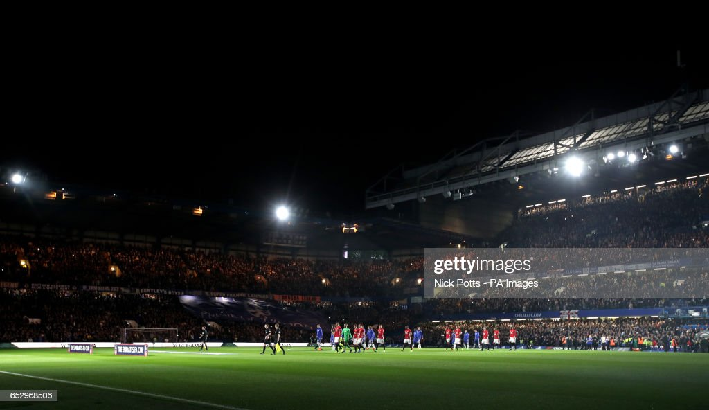 Players walk out for the Emirates FA Cup, Quarter Final match at Stamford Bridge, London.
