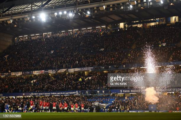 Players walk out for the English Premier League football match between Chelsea and Manchester United at Stamford Bridge in London on February 17 2020...