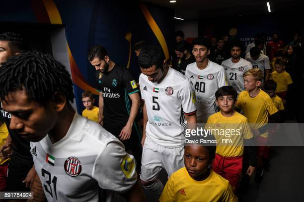 Players walk out the tunnel area prior to the FIFA Club World Cup semi-final match between Al Jazira and Real Madrid CF at the Zayed Sports City...