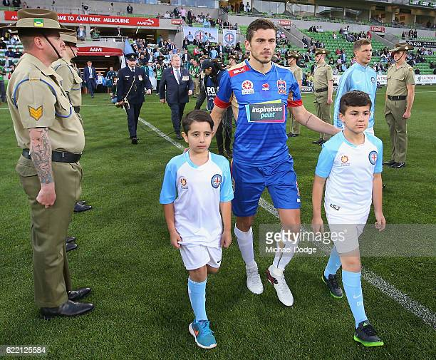 Players walk out through a guard of honour for Rememberance Round during the round six ALeague match between Melbourne City FC and Newcastle Jets at...