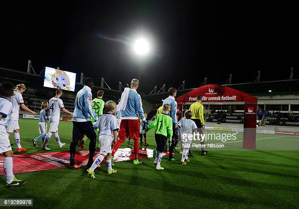 Players walks on the pitch ahead of the Allsvenskan match between Gefle IF and Malmo FF at Gavlevallen on October 30 2016 in Gavle Sweden