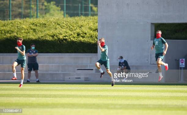 Players warm up a safe distance apart as Southampton FC players return to training following Covid19 restrictions being relaxed at the Staplewood...
