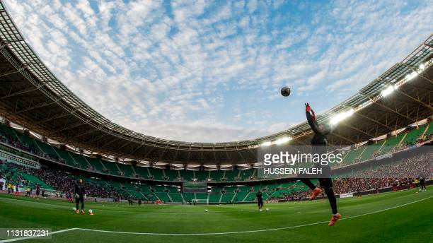 Players warm up ahead of the international friendly football match between Iraq and Syria at Basra Sports City Stadium on March 20, 2019.