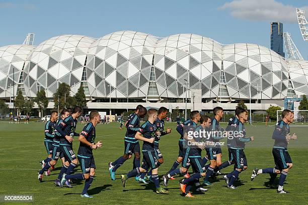 Players warm up before a Melbourne Victory ALeague training session at Gosch's Paddock on December 11 2015 in Melbourne Australia