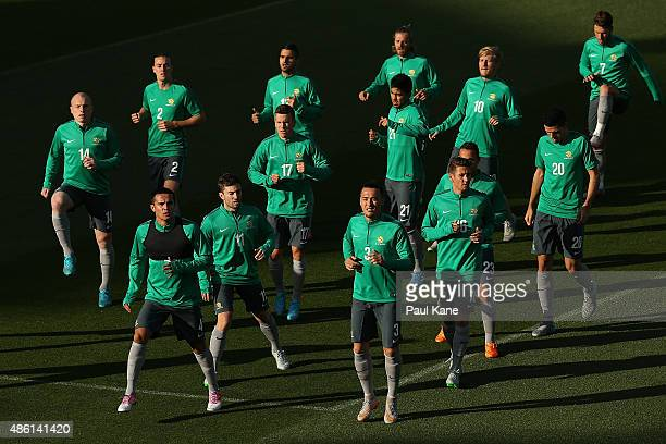 Players warm up before a training session during the Australian Socceroos fan day at nib Stadium on September 1 2015 in Perth Australia