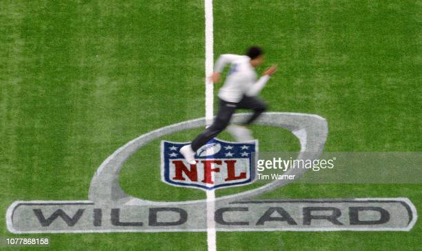 Players warm up before the game between the Houston Texans and the Indianapolis Colts during the Wild Card Round at NRG Stadium on January 5 2019 in...