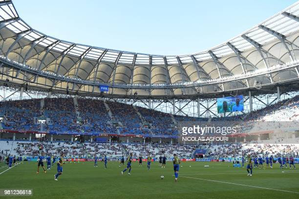 Players warm up before the Russia 2018 World Cup Group D football match between Nigeria and Iceland at the Volgograd Arena in Volgograd on June 22...