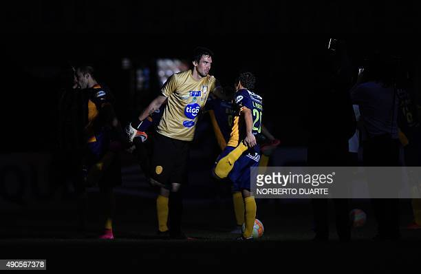 Players warm up during a blackout at the Sportivo Luqueno stadium moments before the scheduled time of the start of the Sudamericana Cup match...
