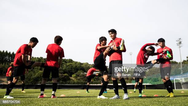Players warm up during a Japan training session for the FIFA U20 World Cup Korea Republic at Suwon World Cup Stadium Auxiliary Field on May 20 2017...