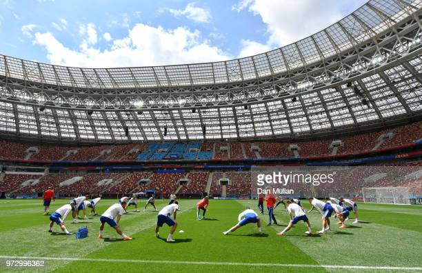 Players warm up during a Russia training session ahead of the 2018 FIFA World Cup opening match against Saudia Arabia at Luzhniki Stadium on June 13...