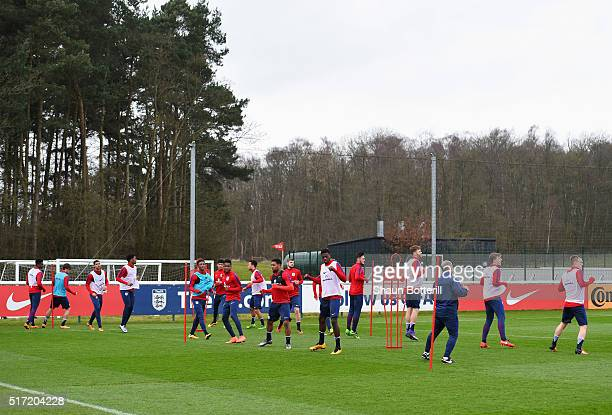 Players warm up during an England U21 training session ahead of their UEFA U21 European Championship qualifier against Switzerland at St Georges Park...