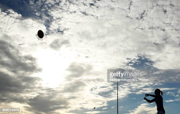 Players warm up during the 2018 AFLW Round 05 match between the Melbourne Demons and the Brisbane Lions at Casey Fields on March 2, 2018 in...