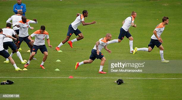 Players warm up during the Netherlands training session at the 2014 FIFA World Cup Brazil held at the Estadio Jose Bastos Padilha Gavea on June 10...