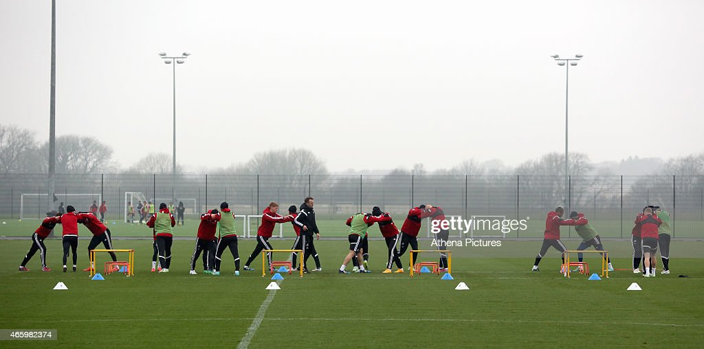 Players warm up during the Swansea City training session at Fairwood Training Ground on March 12, 2015 in Swansea, Wales.